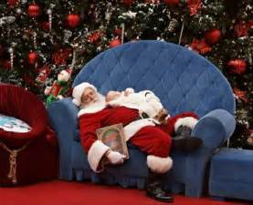 mall santa takes adorable photo with sleeping baby