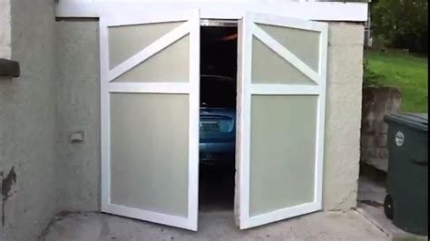 how to keep door from swinging open swinging garage door youtube