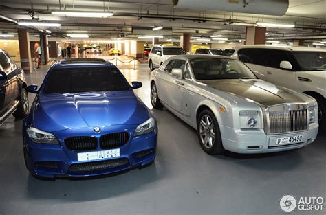 roll royce bmw bmw m5 poses to rolls royce phantom coupe in dubai