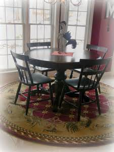 shabby chic flower pattern rug under rustic varnished teak wood dining table set with bench