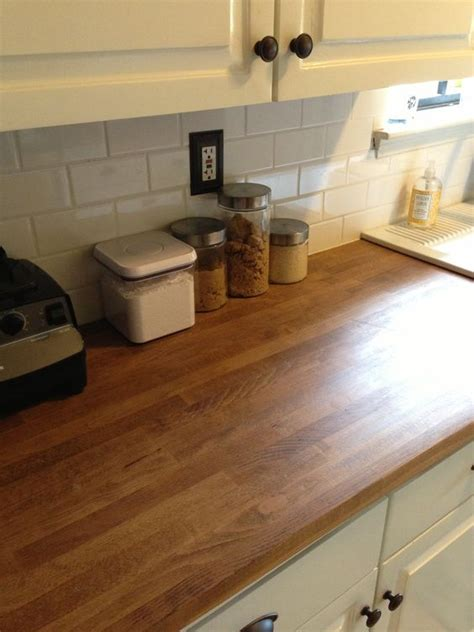 butcher block countertops with the white cabinets