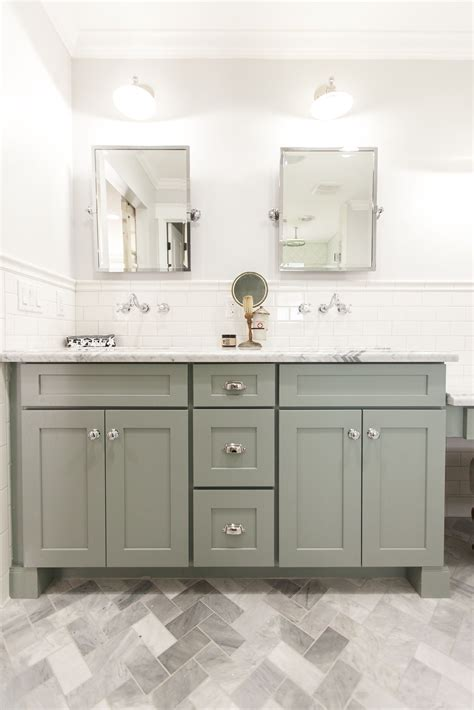 grey shaker style bath vanity with carrara marble counter
