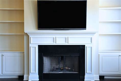 mounting flat screen tv above fireplace how to mount a flat screen the fireplace and hide the