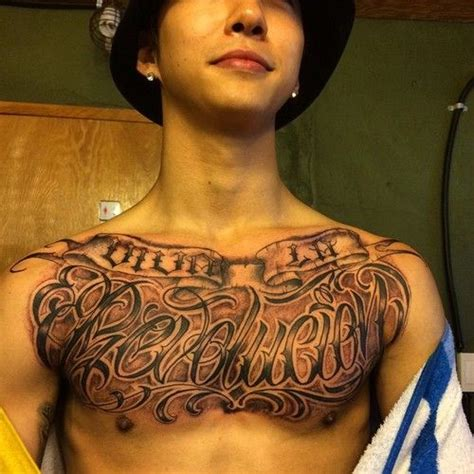 yongguk new tatto it s not really my style but yongguk