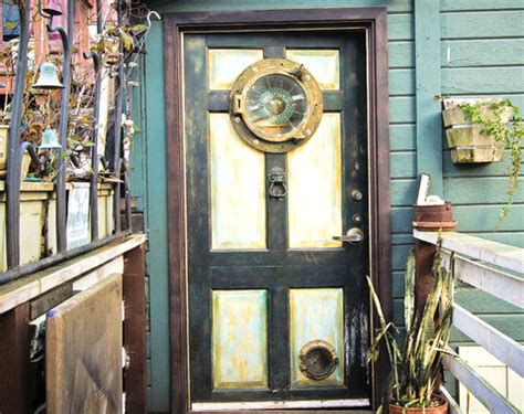porthole windows for houses porthole windows for your home and a door for the cat completely coastal