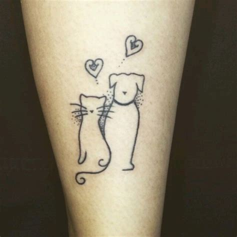 tattoo cat and dog tattoo2me cat and dog on we heart it