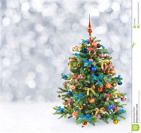 festive christmas tree in winter snow stock photo image