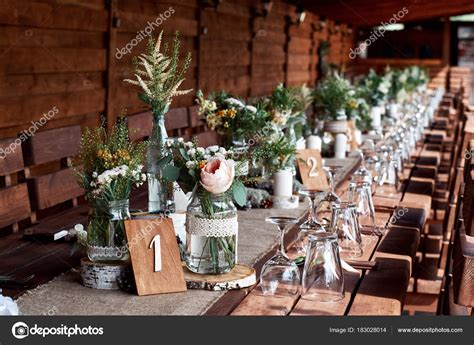 decoracion mesa  flores frescas frascos velas  boda