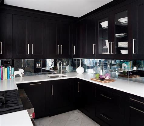 contemporary kitchen features espresso cabinets paired