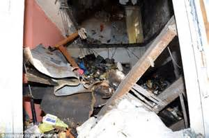 Floor Collapse by Hoarder Rescued From Home After Falling Into Living Room
