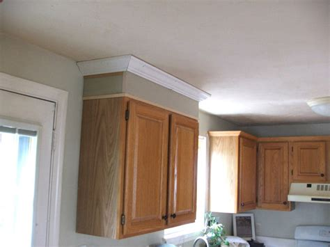 how to make kitchen cabinets look cabinets taller dio home improvements