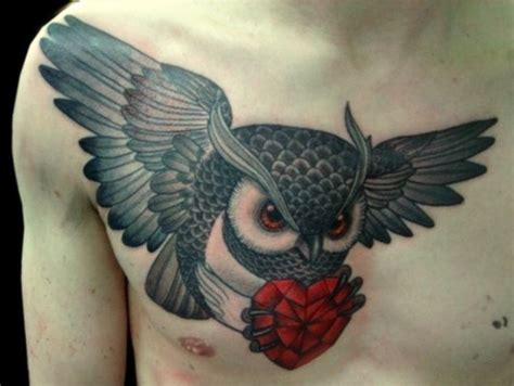 tattoo owl heart flying owl with a red heart in its claws tattoo on chest