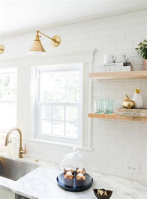 white and gold kitchen features white cabinets adorned 17 best ideas about white subway tiles on subway tile kitchen subway open and