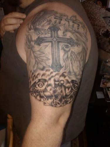 cross arm tattoos for men cross half sleeve