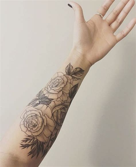 another set of classic roses wraps around the forearm ty
