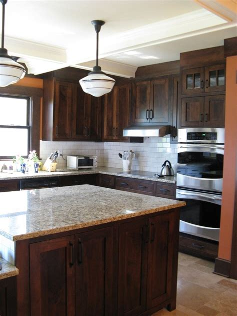 kitchen backsplash for dark cabinets 25 best ideas about stained kitchen cabinets on pinterest