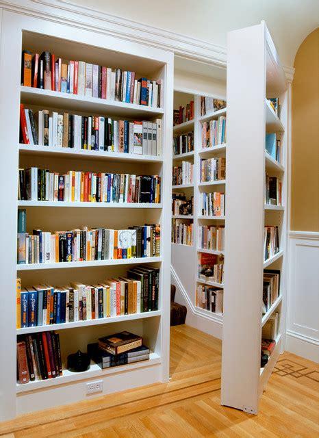wall bookshelve door in wall bookshelf that leads to upstairs suite