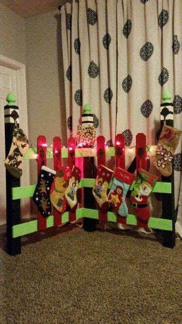 diy christmas stocking holder pallet wood staircase posts christmas stockings diy