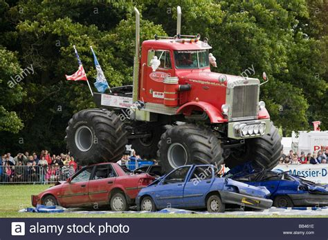 monster trucks show uk monster trucks crushing old cars at a farm show