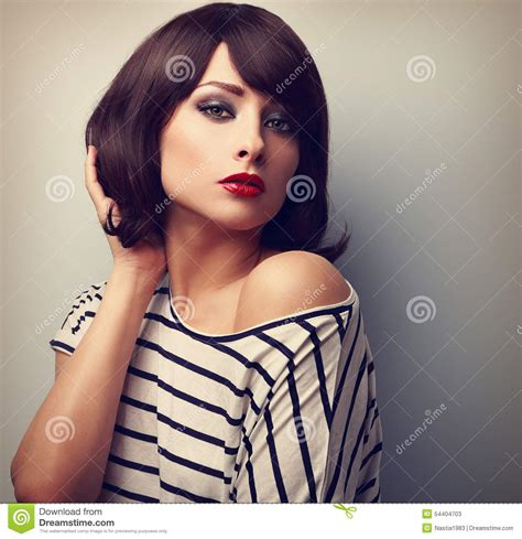 short hair poses beautiful female model with short hair style in casual