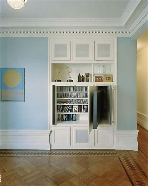 built in shelving unit a compartment in this built in shelving unit allows the tv