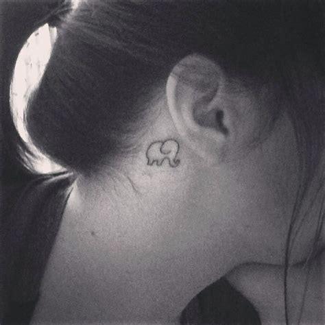 small elephant tattoo behind ear 36 elephant tattoo trunk up