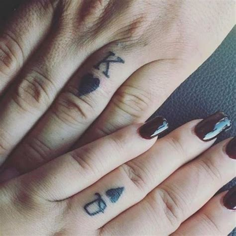 queen tattoo on ring finger 50 king and queen tattoos for couples herinterest com