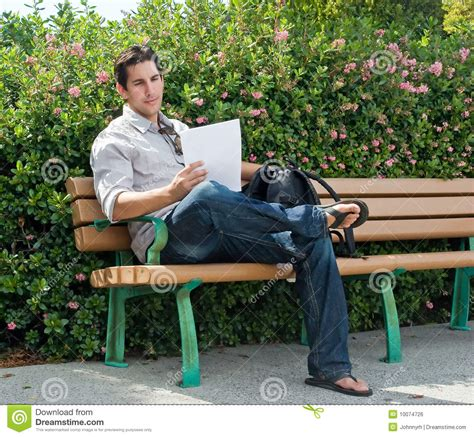 sitting in a park bench sitting on park bench royalty free stock image image