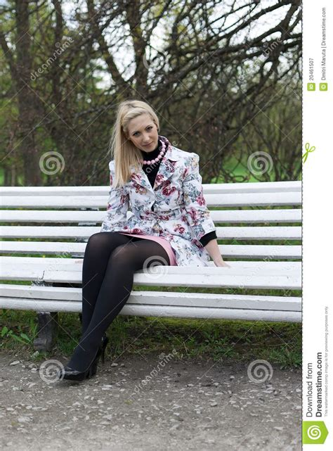 blonde girl sitting   park bench stock image image