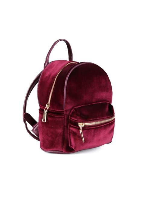small backpack an adorable tiny backpack featuring a velvet exterior and leather straps straps are