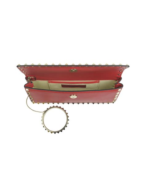 Clutch Redrock lyst valentino rockstud leather clutch in