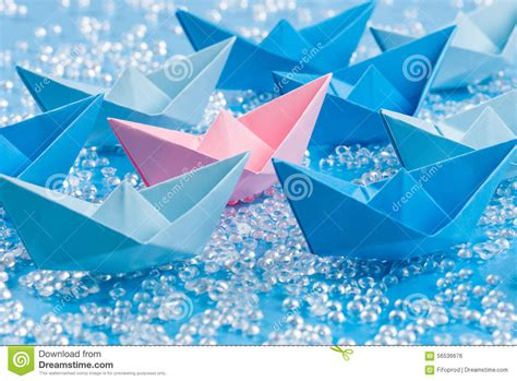 origami love boat love boat fleet of blue origami paper ships on blue water