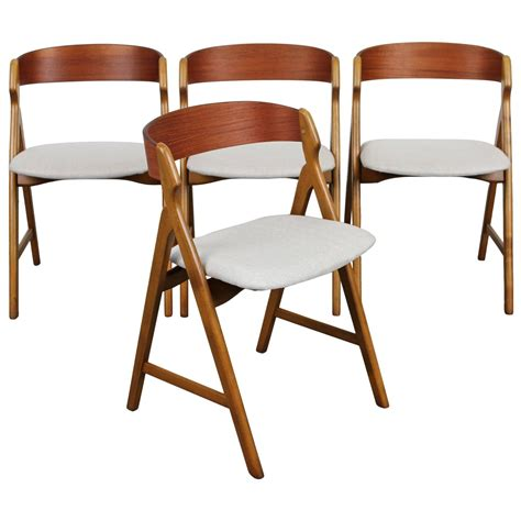 set of four mid century modern teak dining chairs