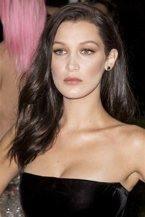 bella hadid wavy medium brown side part hairstyle steal