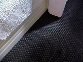 Black bathroom floor tile including the tile