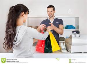 customer buying clothes in shop royalty free stock
