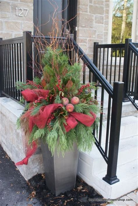 christmas decorating huge stone urns in front of entrance best 25 urns ideas on planters outdoor planters and