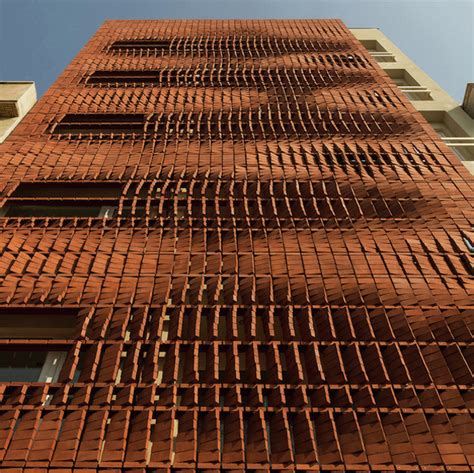 designer architect admun pleases both economy and privacy with brick screen