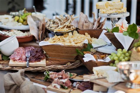 wedding reception with food stations antipasto station at outdoor wedding reception onewed