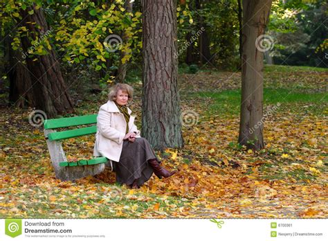 sitting in a park bench stock image man sitting on a park bench male models picture