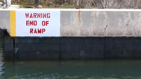 boat launch huntington harbor end of r warning sign on boat launch r stock footage