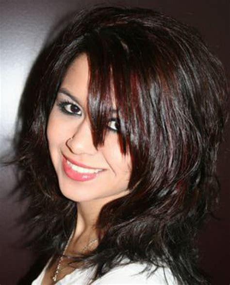 layered razor hairstyle for thick hair razored layered haircuts