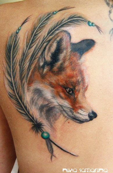 fox head tattoo colorful fox and charm of feathers tattoos
