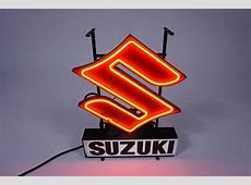 Hard-to-find 1960s Suzuki Motorcycles neon dealership sign. L Insurance Auto Auctions