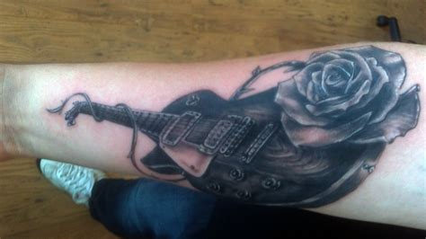 guitar with roses tattoo guitar and fave ink
