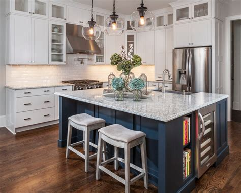 kitchen island different color than cabinets consider painting your island a different color than your cabinetry the navy used here warms up