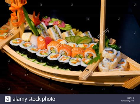 sushi on a boat assortment of sushi on a wooden boat shaped platter