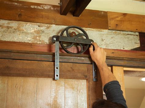 diy sliding barn door track how to build a sliding barn door diy barn door how tos