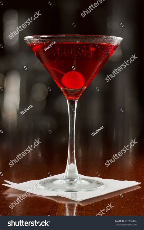 red martini restaurant red cocktail served on busy bar stock photo 132736496