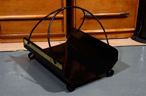 mid century black metal and brass fireplace log holder at